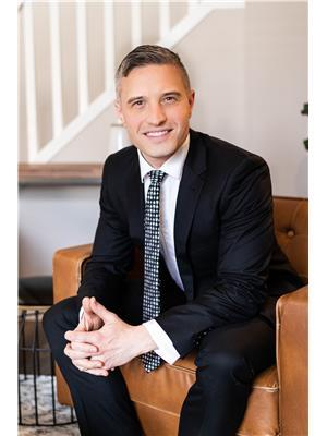 Adam J. Benke