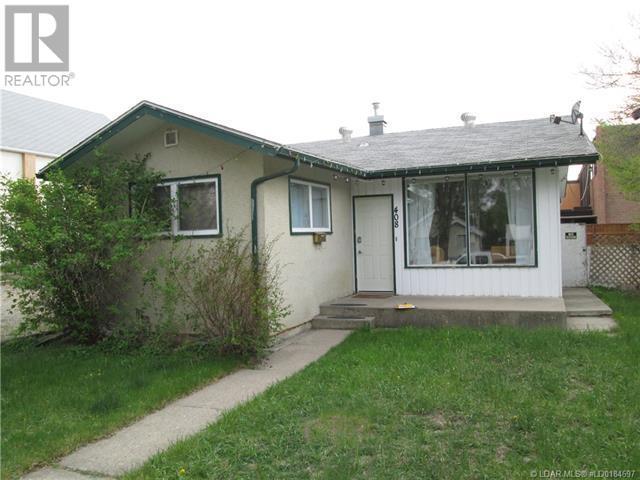 408 12 Street S, Lethbridge, Alberta  T1J 2R4 - Photo 1 - LD0184697