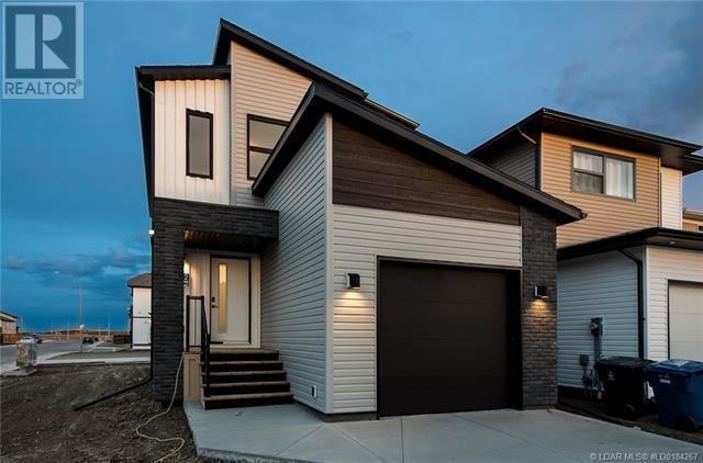 902 Pacific Way W, Lethbridge, Alberta  T1J 5N4 - Photo 1 - LD0184267